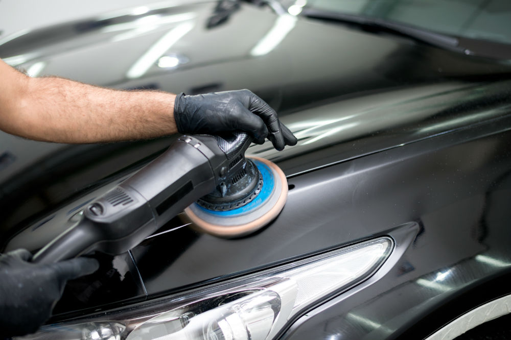 guy buffing black car